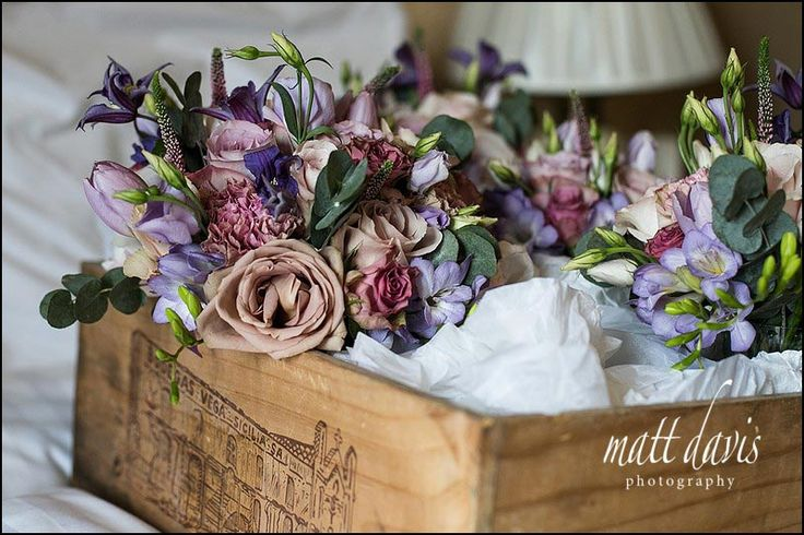 Wedding Bouquet With Dusky Pink And Purple Roses And Country Garden Flowers Presented In