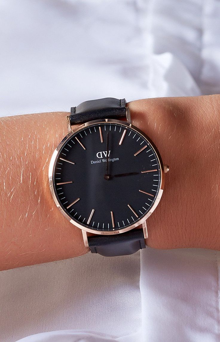 Let's go black to black with the Daniel Wellington Classic Black Sheffield watch! This watch is so timeless and classic with a black face and delicate rose gold hands and details. The leather is a beautiful and soft Italian leather that is interchangeable too! This watch also comes with a gorgeous brown and cream embossed box, that includes Daniel Wellington's 24 month warranty! This watch can go from day to night, with jeans and a cute tee to a chic black dress on a night out with the gi...