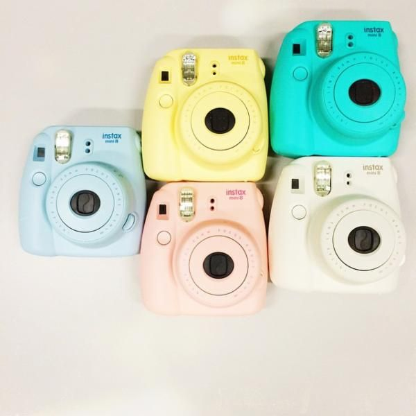 Fujifilm Instax 8 mini. - If I have instant pictures then maybe all our picture frames will finally be of some use. White, blue, or pink