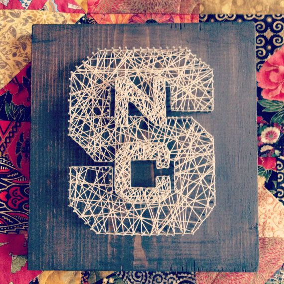 NCSU Wolfpack custom string art wall decor item on dark finished wood, 12in x 11.5in. $100.00, via Etsy.