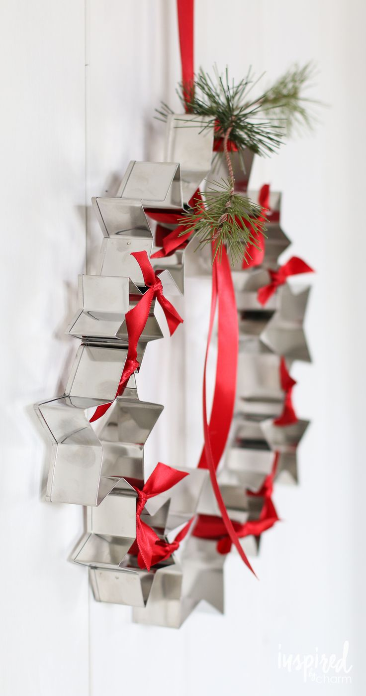 This wreath is made from cookie cutters. You won't believe how simple it is to create. Get the tutorial via inspiredbycharm.com #IBCholiday