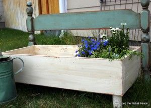 Make a flower planter out of a headboard - part of the Farmhouse Friday roundup series at www.knickoftime.net