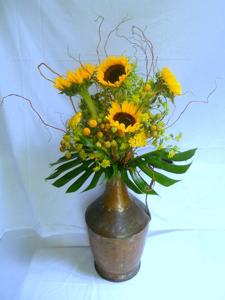 Tall Vintage Turkish water vessel filled with sunflowers; displayed @ a bridal shower party.