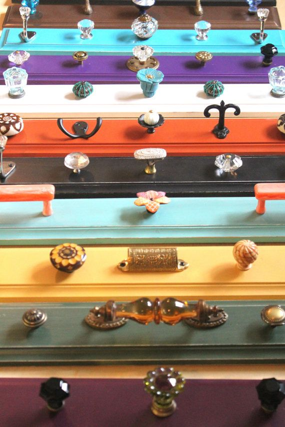 Different drawer pulls and knobs to make a wall hanging rack.