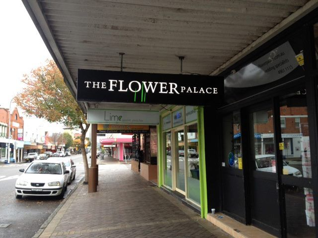 neon sign for the flower palace