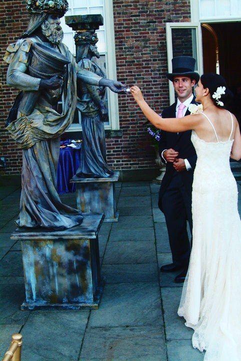 Living Statue Wedding Pillars - great for passing out programs or favors. Unique entertainment option #uniqueweddingideas #livingstatues