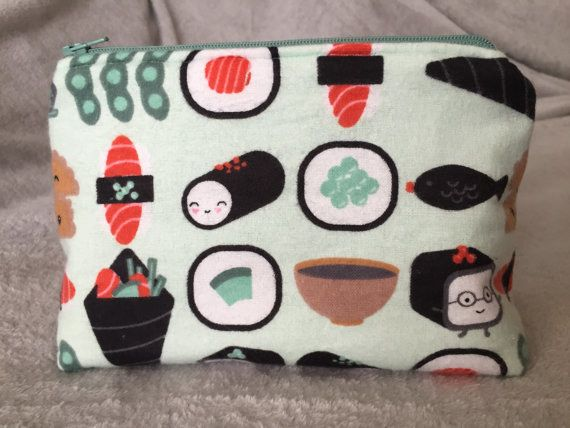 This adorable sushi case, rolls not included. | 23 Makeup Bags That Will Make You Feel Like You Have Your Shit Together