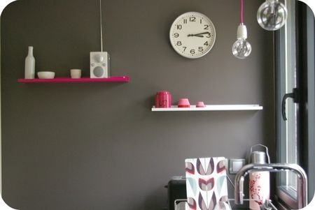 grey wall with colorful shelves in the kitchen