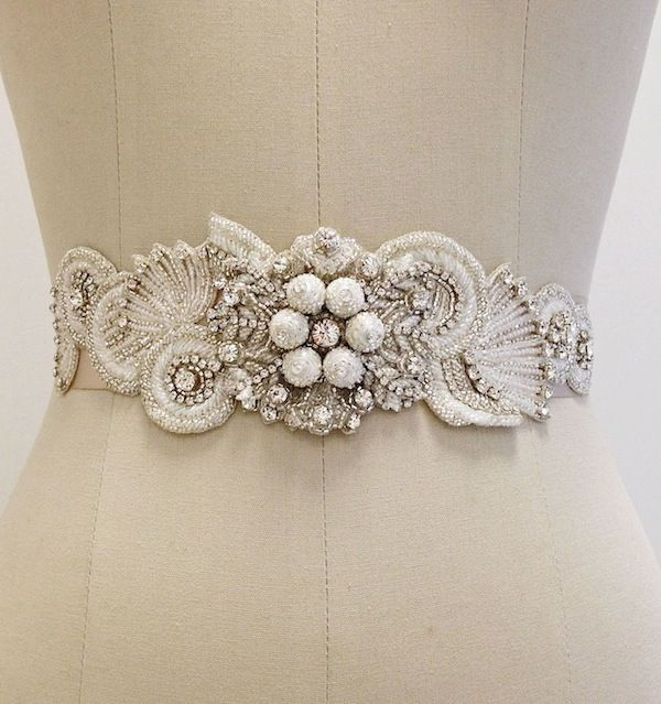 Erin Cole Bridal Sashes, Belts, Accessories. Stunning beaded bridal sash with swirls of circular beadwork finished with chatan balls at the center.