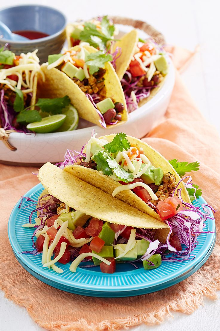 This easy, homemade taco recipe is made with flavoursome pork mince, a fresh tomato and avocado salsa and kidney beans for a delicious family dinner idea.