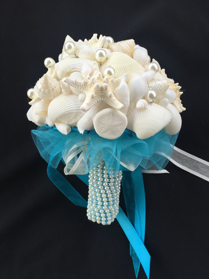 A stunning bouquet of natural white seashells and shiny pearls makes this the perfect bouquet for any beach wedding. The pearl handle and organza skirt compliment its natural beauty.   All bouquets can be reproduced in the size and colour of your choice. Feel free to mix and match ideas to make your bouquet more individual. Corsage, MOB and Lapel pins are also available to match your colours. Contact leeann@bejewelledbridal.com.au for more information.