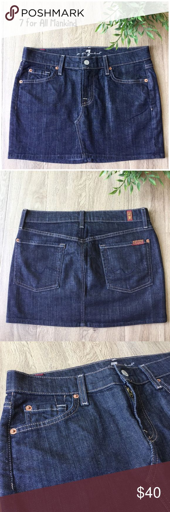 """7 for All Mankind Roxy denim mini skirt size 28 A cute dark wash denim skirt to get you in the mood for fall.  * Roxy style * Angled hem accent across front center * Front and rear pockets * Darker wash * Waist: 16"""" approx. laying flat * Length: 13"""" approx. from armpit to hem short side * 98% cotton, 2% Lycra * Machine wash, tumble dry * Excellent used condition  * Bundle discount * No trades * Smoke free, pet friendly home 7 For All Mankind Skirts Mini"""