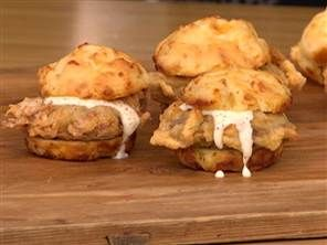 Chicken fried steak sliders with white gravy on buttermilk cheddar biscuits...by Chef Roble. The recipe is linked in the comments.