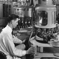 Working at the Spring Street Coca-Cola Bottling Company plant in 1950. Description from atlantahistorycenter.tumblr.com. I searched for this on bing.com/images