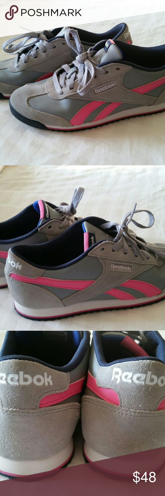 Women's Classic Reebok Running Shoes Grey suede and smooth leather with pink accent  Light discoloration on back Right heal, not super noticeable or obvious. Reebok Shoes Sneakers