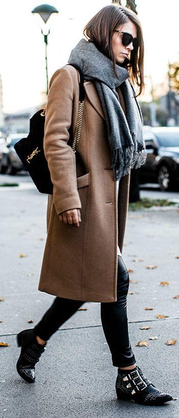 Gold details + add interest + lux street style + Nina + iconic + exquisite camel coat + leather leggings.  Coat: Marc'o Polo, Scarf: Acne, Shirt: Asos, Pants: BCBGMAXAZRIA, Boots: Bronx, Bag: Saint Laurent, Sunglasses: Le Specs