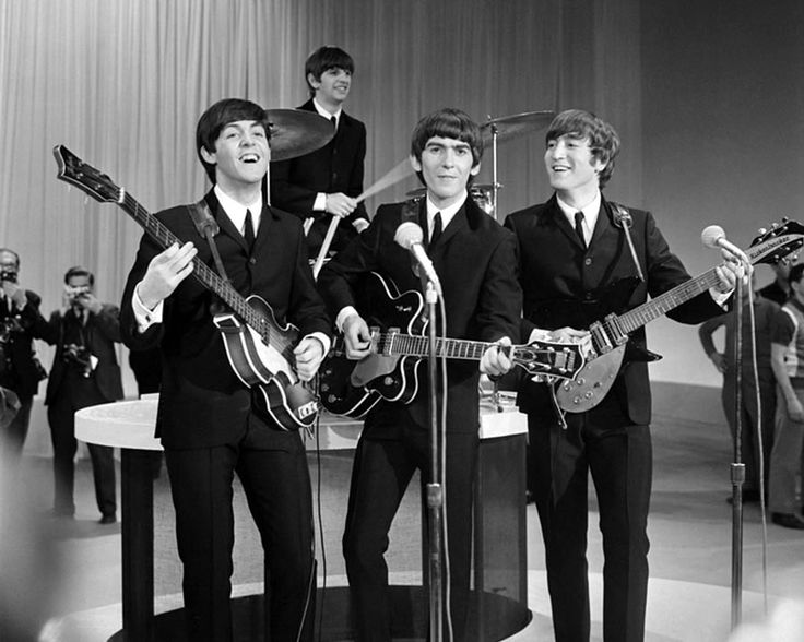 The Beatles at the Ed Sullivan Theater in New York City on the day of their legendary February 9, 1964 performance.