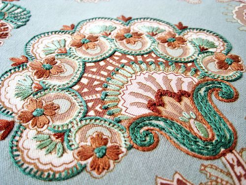 Embroidery over fabric print...by catnipstudio  Teal Paisley Hand Embroidery, via Flickr.