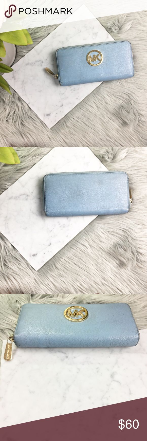 """Michael Kors Fulton lt blue  continental wallet Classic and functional wallet in a lovely powder blue. Logo gold hardware. zip up closure keeps everything secure.   - 8 card slots - inner zipper pocket - Leather , color: powder blue  - 8-1/4"""" W x 4"""" H x 3/4"""" D - Top zip closure  Condition: Pre owned. Some minor general wear on exterior logo. Interior is spotless. This wallet is in great condition Michael Kors Bags Wallets"""