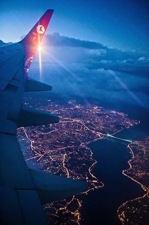 Turkish Airlines Flying Over Colorful Istanbul In Night Turkey