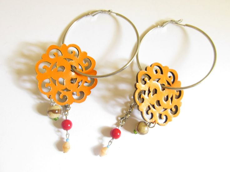 Handmade laser cut leather earrings (1 pair)  Made with orange leather filigrees, silver tone antiallergic earring hoops, beige coral stone and glass beads.
