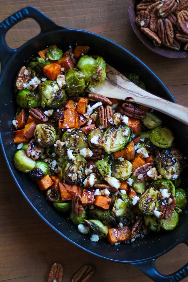 Roasted Brussels Sprouts and Sweet Potatoes with feta, pecans, and balsamic reduction - a healthy side dish for fall! #healthy #recipe #vegetarian