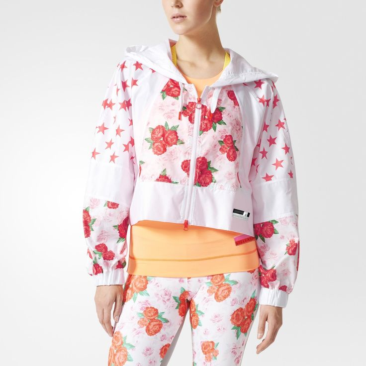 Fresh pops of color and bold patterns define this season's adidas STELLASPORT collection. A team effort between adidas and Stella McCartney, the line puts Stella's fun, youthful spin on favorite sportswear styles. Flowers and stars come together on this breathable, water-repellent women's training jacket. The top's wide, cropped fit and batwing shape is a signature of this season's adidas STELLASPORT collection.