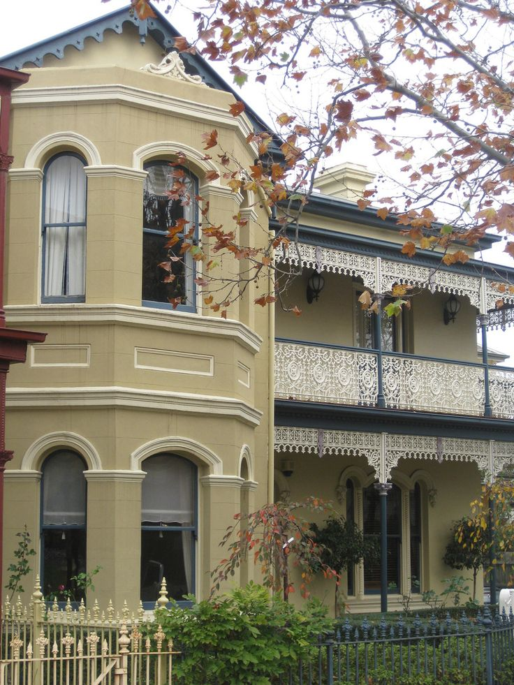 A magnificent late Victorian boom period terrace house in the inner northern Melbourne suburb of Flemington. Built between the 1880s and the 1890s, this residence features bay windows upstairs and down, stuccoed brick facade (with exposed red brick walls at the side elevations), large sash windows and two chimneys. However its crowning glory must be without doubt its wonderful verandah and balcony with its intricately frilly lace like wrought iron fretwork.