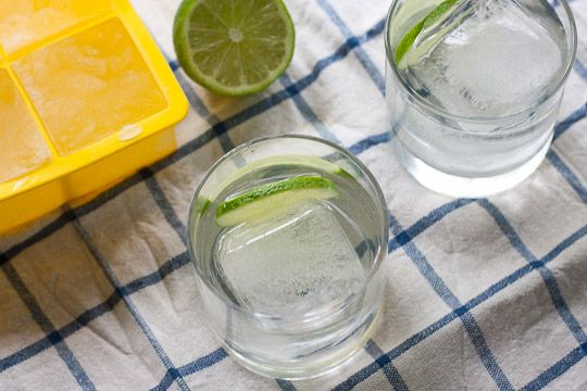 make ice cubes out of tonic...or cranberry juice...or any other mixer to avoid watering down your drinks