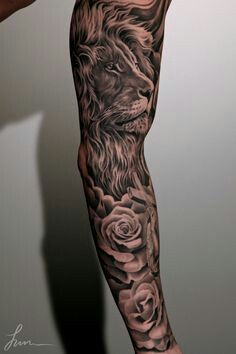 Sleeve tattoo with a beautiful lion and roses