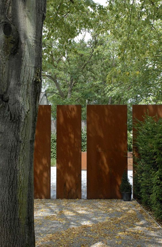 solid metal panels : Very modern and sophisticated. Solid steel plates of random width adds a touch of imagination to the rather imposing installation.