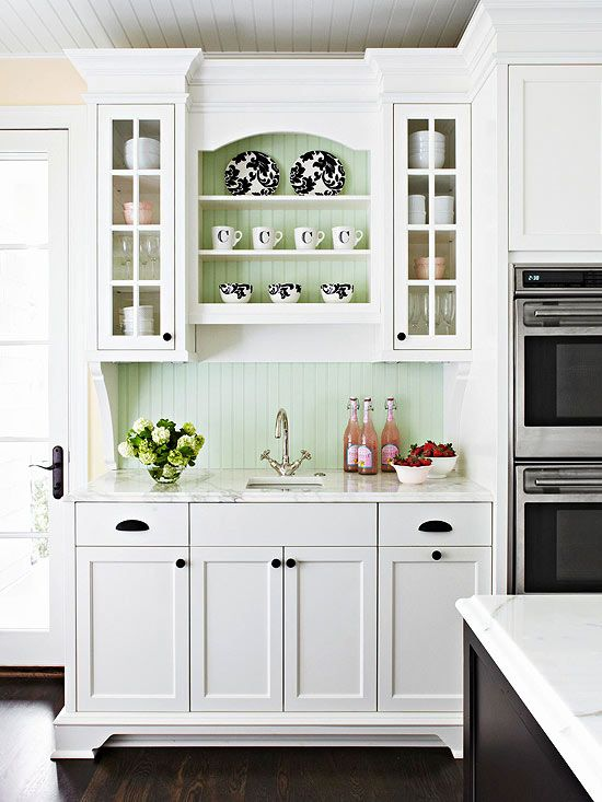 a minty green beadboard backsplash adds a touch of color to a white cottage kitchen