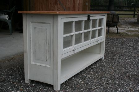TV console made from an old window and old doors for the side panels.
