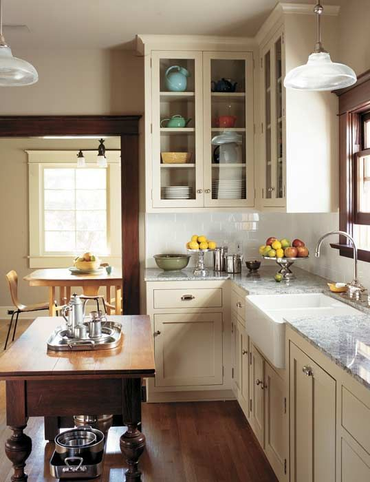 Creamy paint, simple nickel fittings, a big sink, and stone countertops fit well in this Craftsman bungalow-- but the look is transitional and timeless.