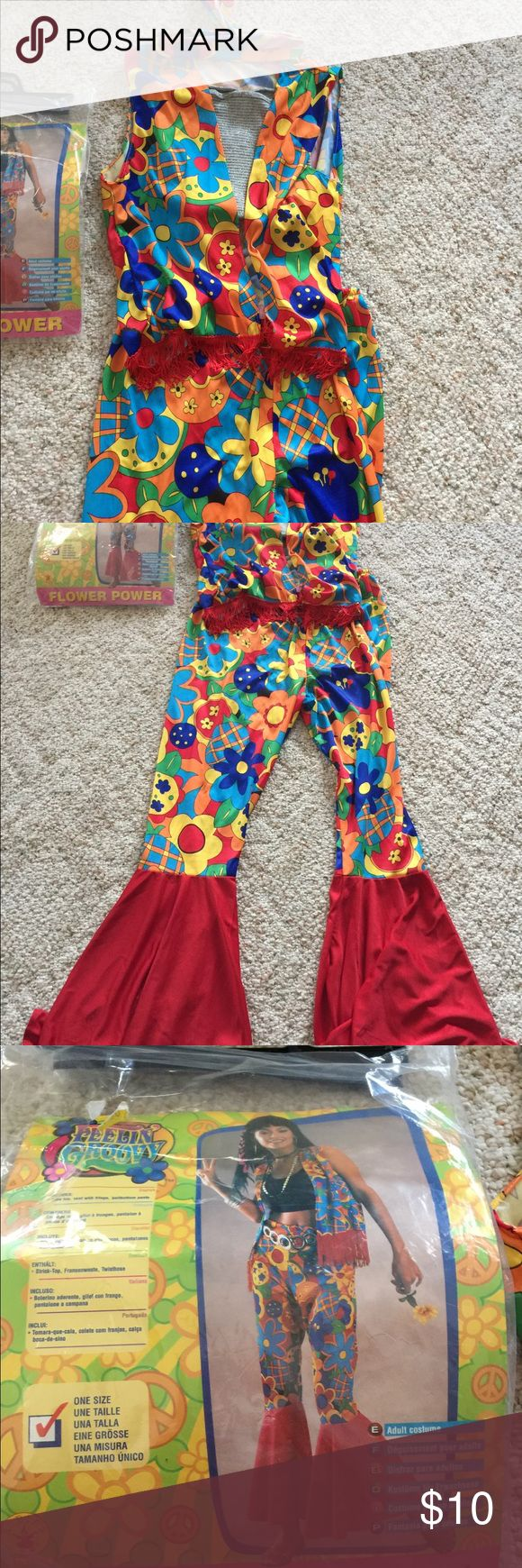 Feelin Groovy Flower Power Costume Pre Owned Feelin Groovy Flower Power Costume. Comes with Silver Tube Top. Vest, Pants and Headband. Other