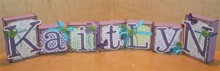 Personalized Boutique Custom Boys/Girls Baby Child Name Wood Block Letters Purple Butterflies & Dash of Darling Boutique Name Blocks. $39.00, via Etsy.