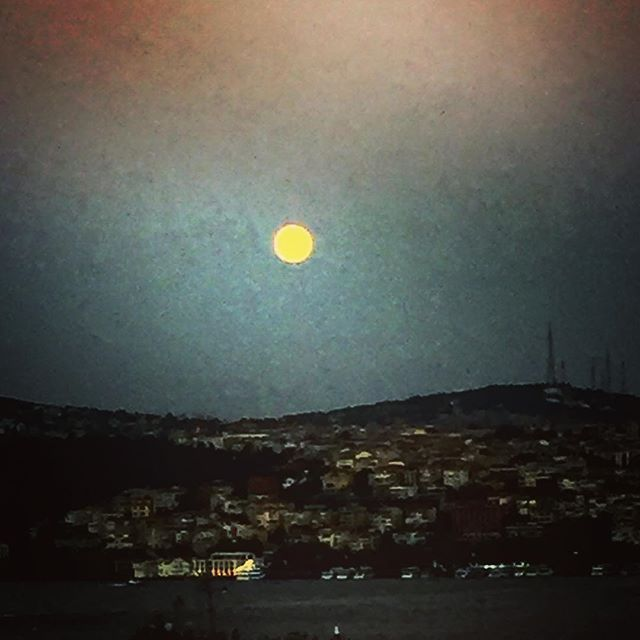 The moon and the city