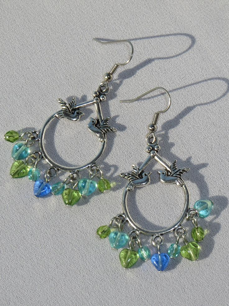 Lovebirds - Chandeliers with hearts and beads : Czech glass, Tibetan silver (a zinc-based alloy, not silver), stainless steel hooks, backings included. A Generous 2 inches in length. $15 https://www.facebook.com/ThielenJewelry/photos/a.1051830928162271.1073741861.213923508619688/1057654610913236/?type=3&theater