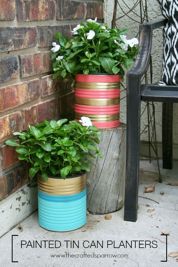 Painted Tin Can Planters.  Turn old cans into outdoor planters with paint, perfect way to add color to your space on a budget. thecraftedsparrow.com