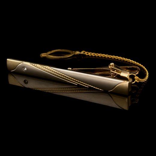 Táto kravatová spona je pozlátená rýdzim zlatom