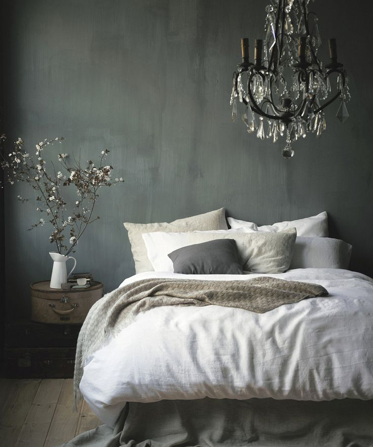 Venetian Plastered wall, White Washed Linen Duvet and simple vase with white flowering branches, Elegant Shabby Chic