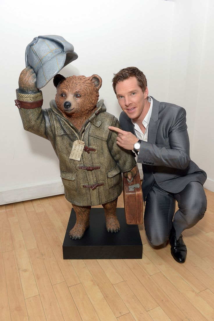 Benedict Cumberbatch with the Sherlock themed Paddington Bear that he designed ah so cute