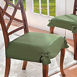 Give your dining chairs a fresh new look with Microsuede Dining Chair Covers.  (if you are wondering... i tied these bows)
