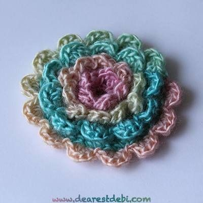 Hook up a quick and easy layered flower with some red heart unforgettable for a unique look every time. http://dearestdebi.com/crochet-simple-layered-flower