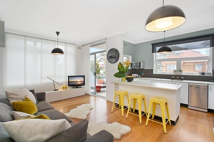 Grey and white kitchen with yellow accents