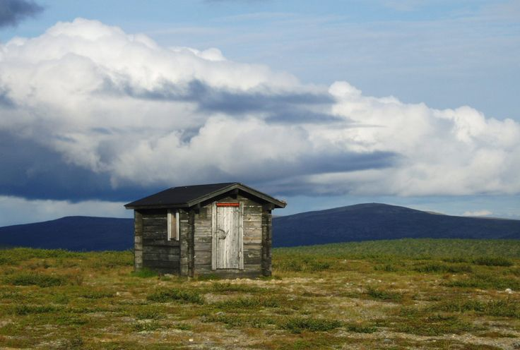 A former telephone hut converted into a wilderness library and resting cabin in Lemmenjoki, Finland.