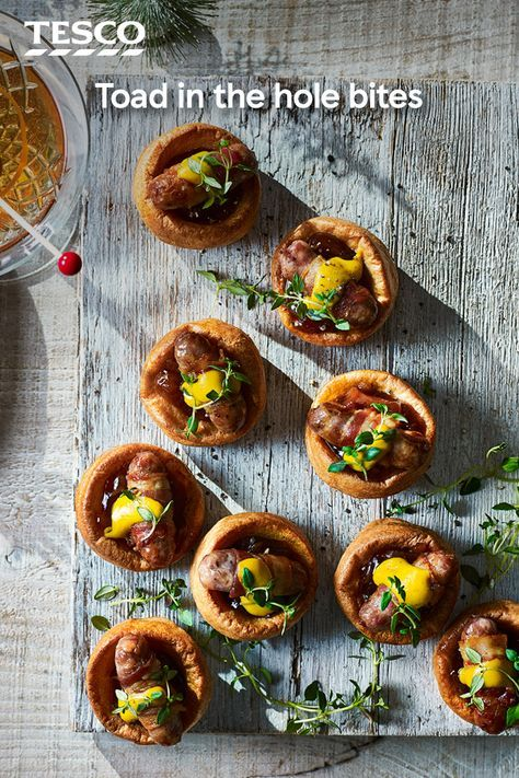 Everyone will love these mini toad-in-the-hole canapés, with fluffy Yorkshire puds and pigs-in-blankets. This easy recipe uses ready-made ingredients, so all you have to do is cook and assemble ready for your Christmas party. | Tesco