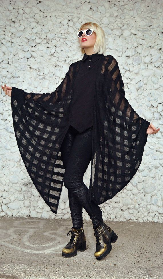 Extravagant sheer black blouse made of a cotton front top and loose extravagant acrylic sleeves. Playful blouse that will steal the thunders at parties, being the center of attention. Material: cotton front - 95% cotton, 5% elastane sleeves - 100% acrylic Care instructions: Wash at 30 degrees.  The model in the picture is size S.  Can be made in ALL SIZES.  If you have any other specific requirements, do not hesitate to contact me!  I DO NOT CHARGE EXTRA MONEY for custom made items.   All…