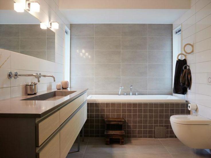 LUNT OG INNBYDENDE: Baderomsinnredningen er fra Kvik, medKuma vask, som er enkel å holde ren.Flisene er fra Flisekompaniet. Enrustikk krakk fra Home og Cottage, girden stramme stilen et mykt løft.