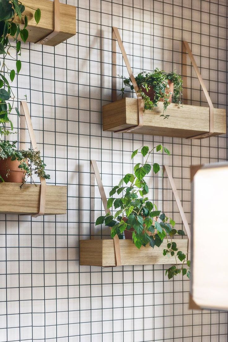 DIY planters hang from steel grid